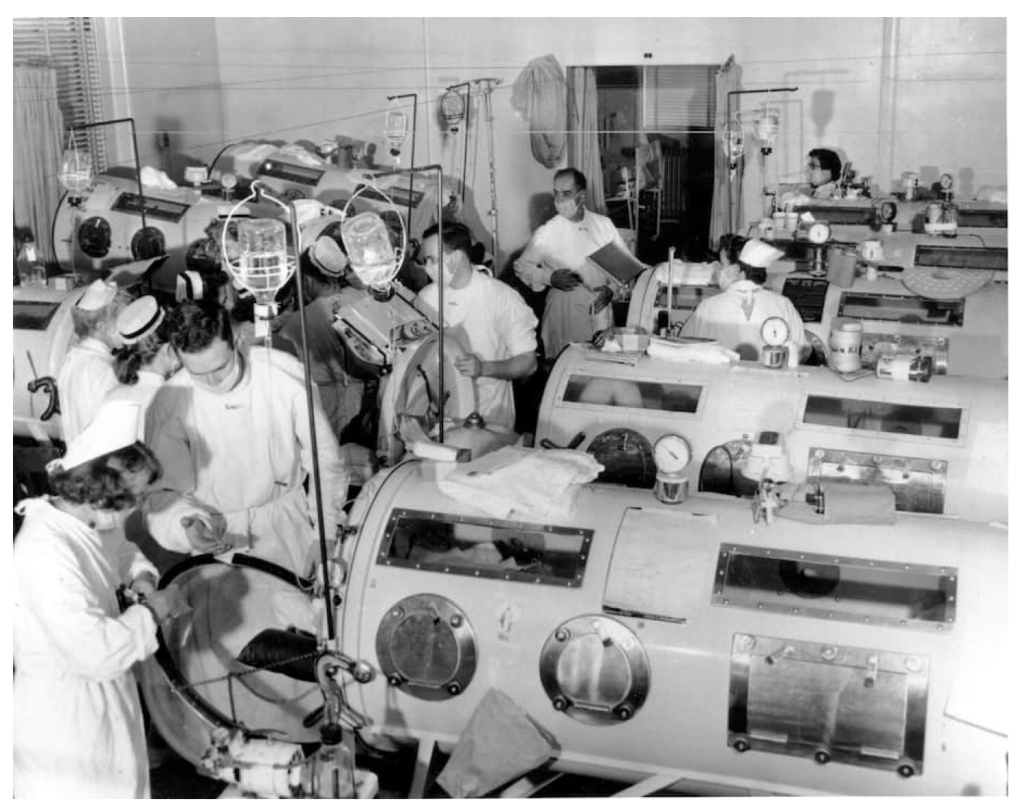 The polio ward in 1955 at Haynes Memorial Hospital in Boston, where iron lung respirators helped patients breathe. (AP)